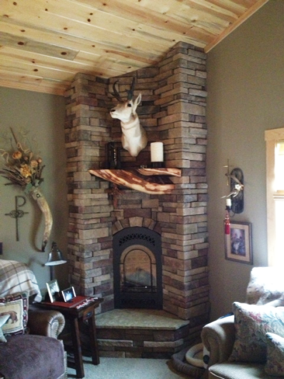 Chads Creation: Driftwood Mantle in Custom Home